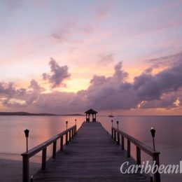 "Sunset on the jetty at Rosewood Jumby Bay, with the Antigua ""mainland"" in the distance. Photograph courtesy Rosewood Jumby Bay"