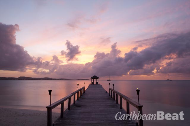 """Sunset on the jetty at Rosewood Jumby Bay, with the Antigua """"mainland"""" in the distance. Photograph courtesy Rosewood Jumby Bay"""