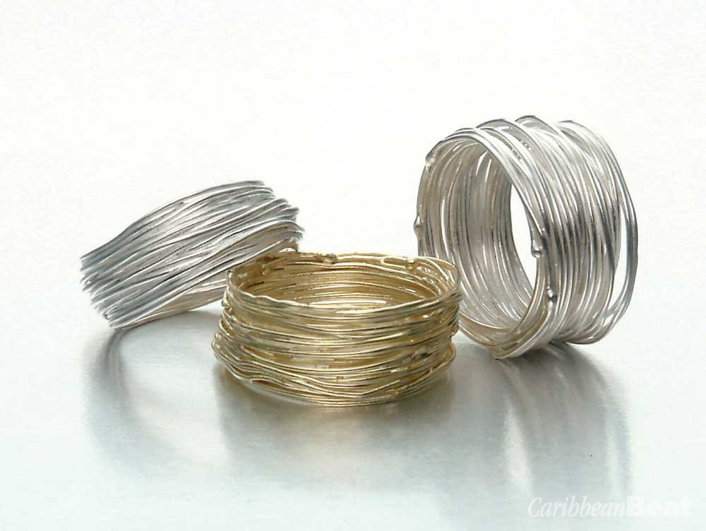 Sterling silver and 18-carat yellow gold fine wire coiled rings. Photography by Michele Jorsling
