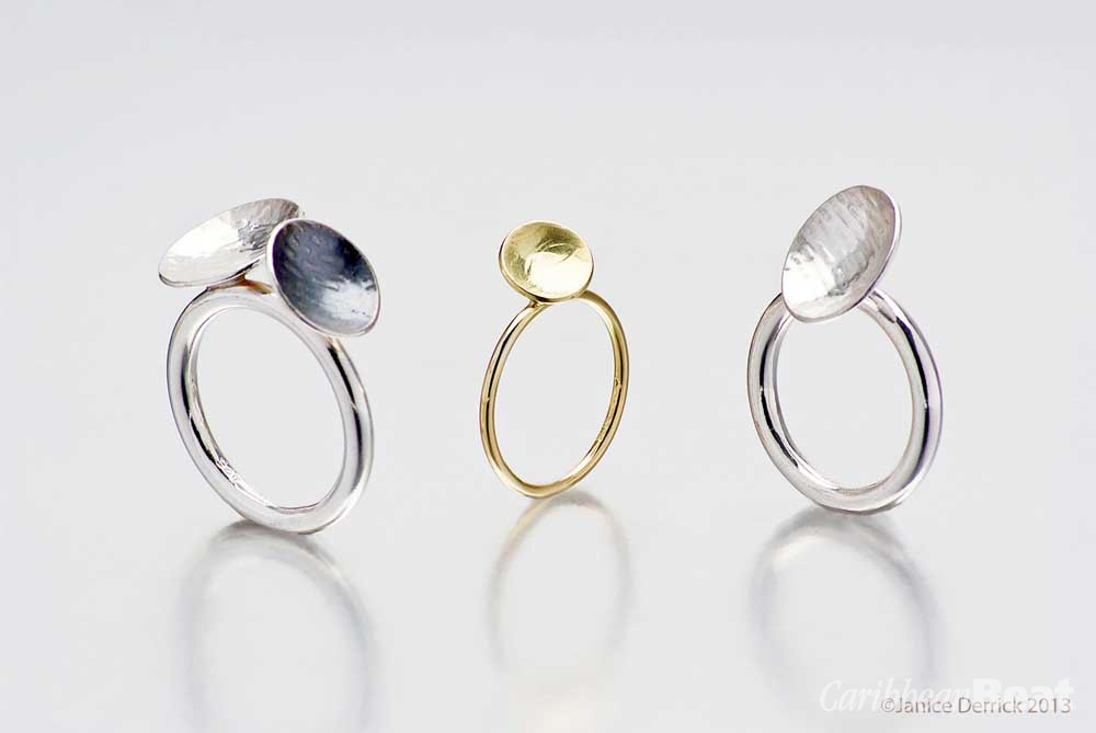 Fine and sterling silver, oxidised silver, and 18-carat yellow gold textured rings. Photography by Michele Jorsling