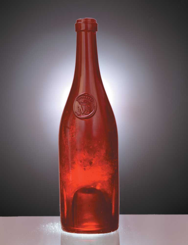 Mid-1800s French bottle from the Champagne house Möet of Rheims. Unusual for its ruby tinge, which some experts speculate was achieved by tossing gold coins into the molten glass. Photograph by Eric Young
