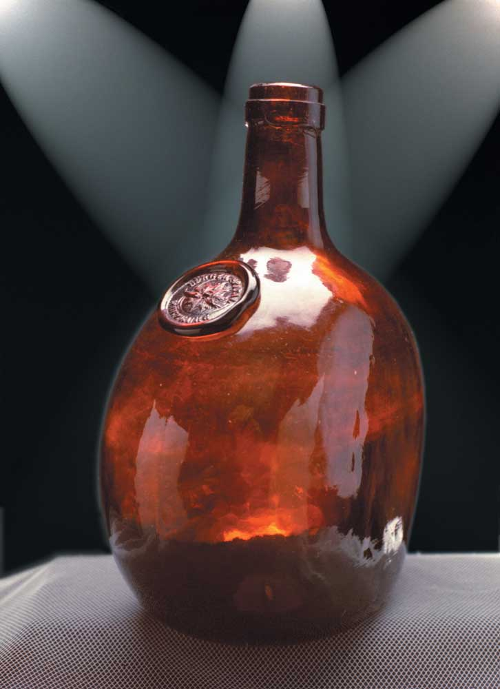 """Red-amber flat-sided German wine bottle, c1860s, with a seal reading """"Burgerspital Würzburg"""" (""""Civil Hospital of Würzburg"""").  Photograph by Eric Young"""