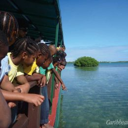 Schoolchildren on an educational tour of Antigua's offshore islands. Photograph courtesy the Antigua and Barbuda Environmental Awareness Group