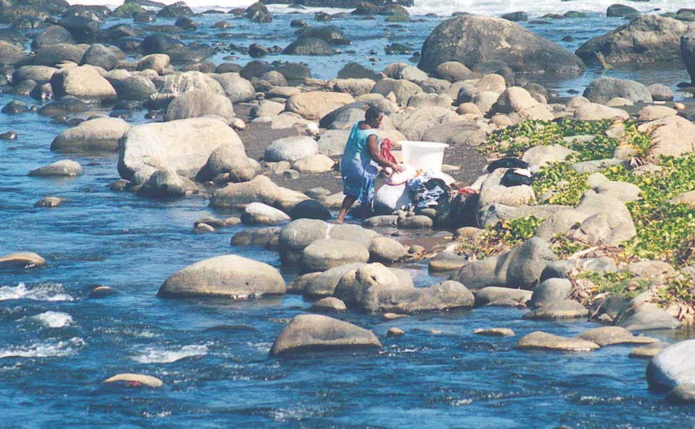 Washing clothes in the river. Photograph by Tony Da Silva