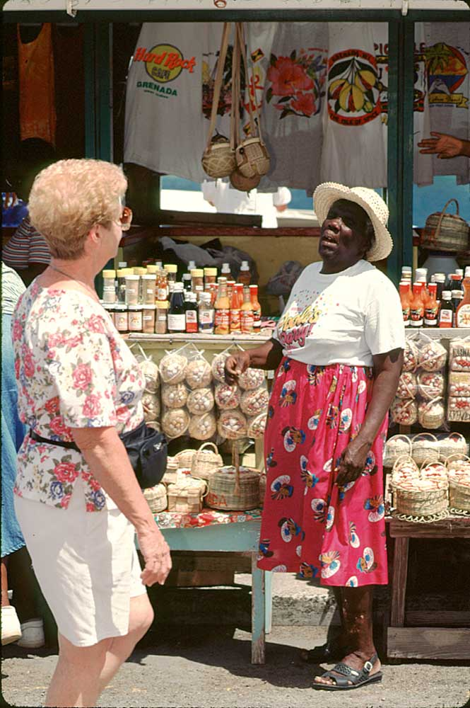 A vendor displays buckets of Grenadian spice and other condiments at St George's market. Photograph by Chris Huxley