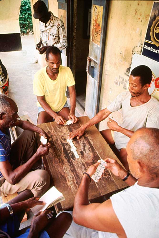 Serious business: dominoes in a Barrouallie rumshop. Photograph by Chris Huxley