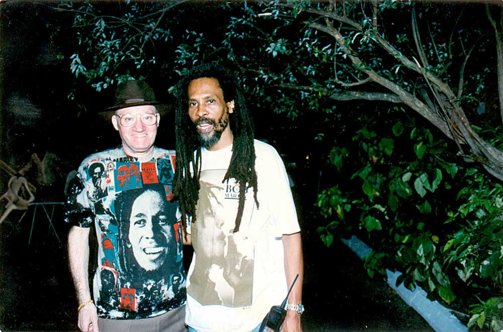 Neville Garrick, right, with the late Charles Comer at the 50th birthday party for Bob Marley at the Tuff Gong headquarters in Kingston, 1995. Photograph by Wendy Steckles