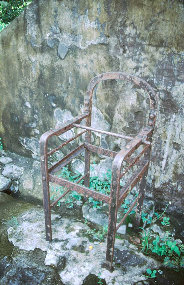 """We visit the old lunatic asylum, a metal chair used for strapping down patients rusting among the ruins"". Photograph by Catriona Davidson"