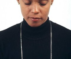 Jasmine wears her own The Conversation (sterling silver, 18ct, carved). Photograph by Mark Lyndersay