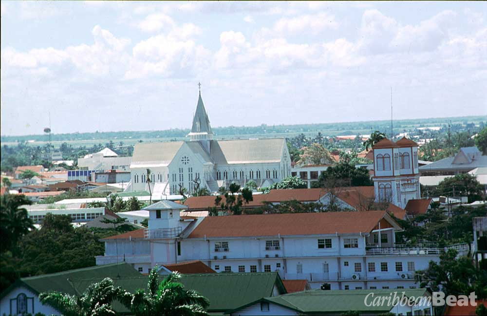 View of Georgetown from the 103-ft lighthouse near the mouth of the Demerara River, dominated by the steeple of St George's Cathedral. Photograph by Roxan Kinas