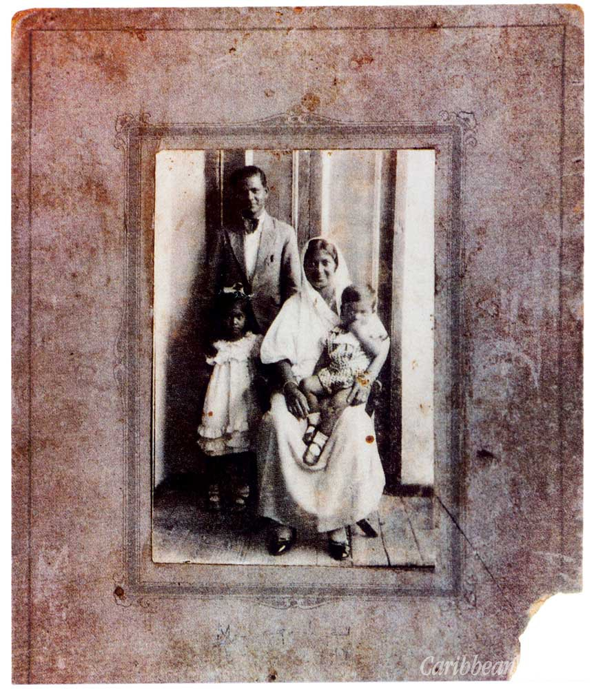 A rare early photograph of Vidia with his parents and elder sister Kamla. Photograph courtesy Mrs Kamla Naipaul-Tewari