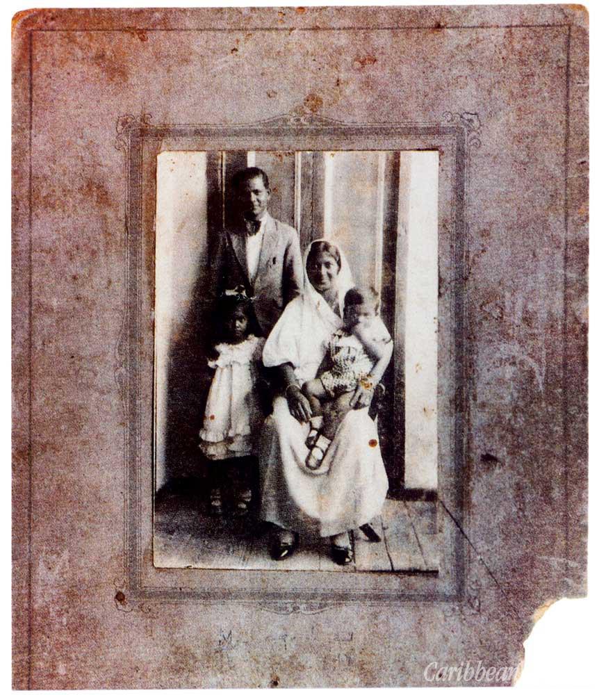 A rare early photograph of  Vidia with his parents and elder sister Kamla. Photograph courtesy Mrs Kamla Naipaul-Tewari