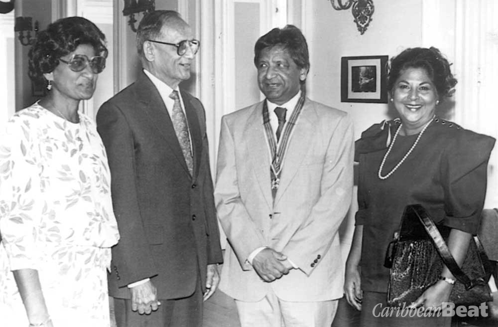 Naipaul and younger sister Savi Akal (right) with former Trinidad and Tobago president Noor Hassanali and wife after being presented with the Trinity Cross. Photograph courtesy Trinidad Publishing Company Limited