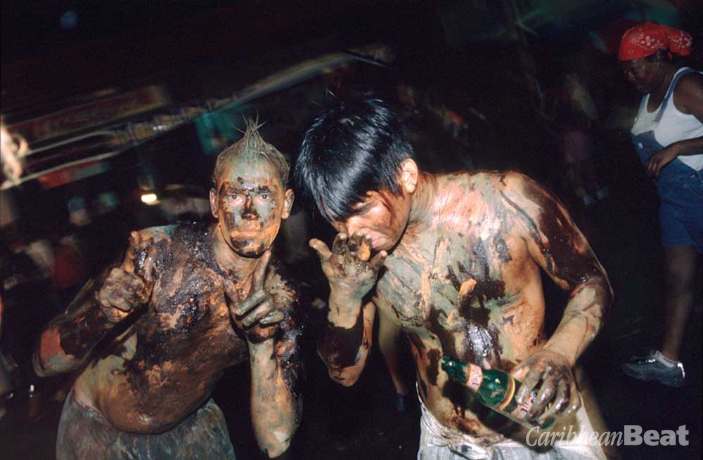 You can't play J'Ouvert and fraid mud, oil or body paint. Photograph by Sean Drakes/Blue Mango