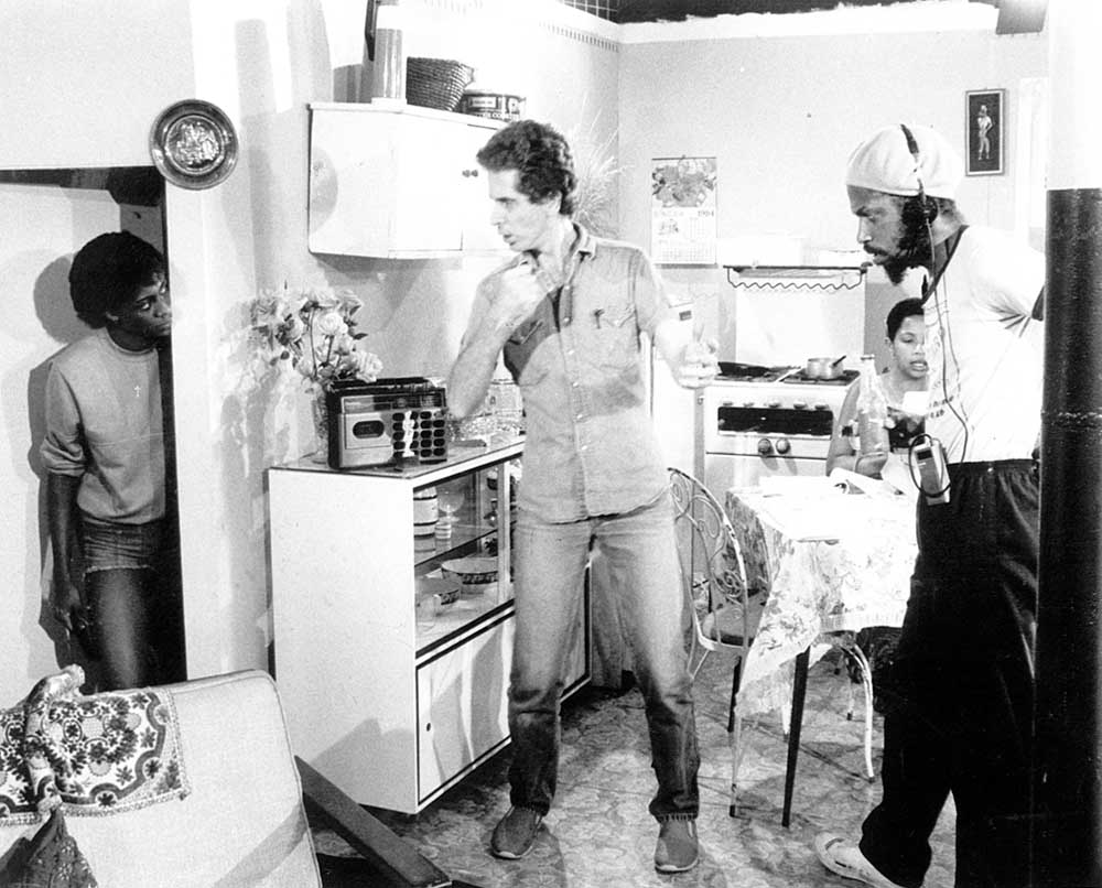 Director's Christopher Laird (2nd from left) and Tony Hall (right) on the set of  Ham for Christmas; 1984. Photograph by Bruce Paddington