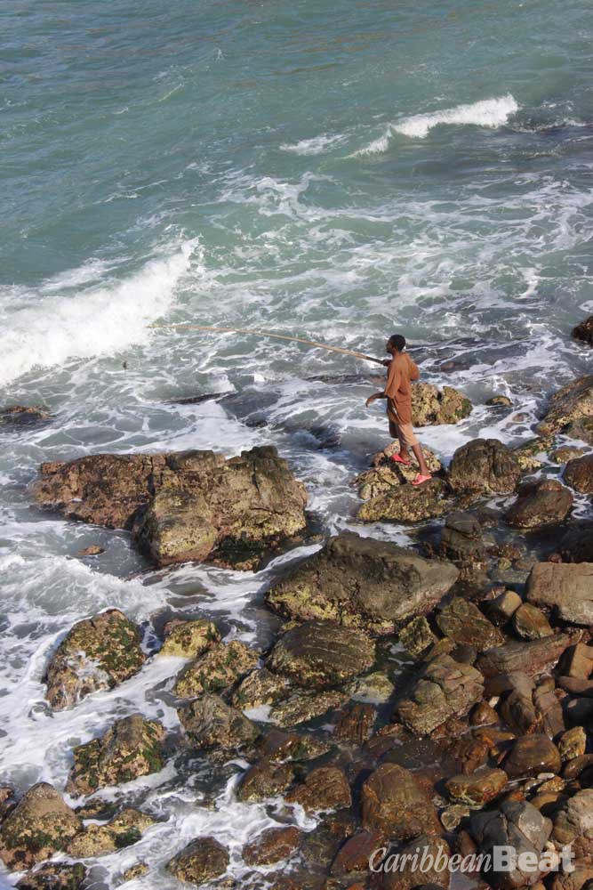 A fisherman casts his line into the pounding surf at Trinidad's Point Galera. Photograph by Chris Anderson