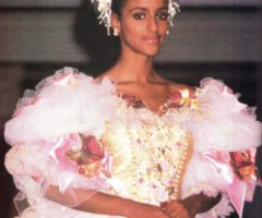 "Sandra Foster, Miss Jamaica 1992, won standing ovations for this ""princess"" gown, a grand extravaganza of hand-painted tulle with pink and gold bodice by Louise Hamlyn Wright"
