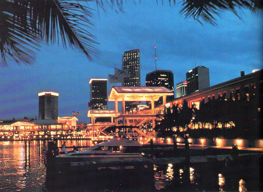 Bayside Marketplace at night, against the Miami skyline. Photograph by Greater Miami Convention and Visitors' Bureau