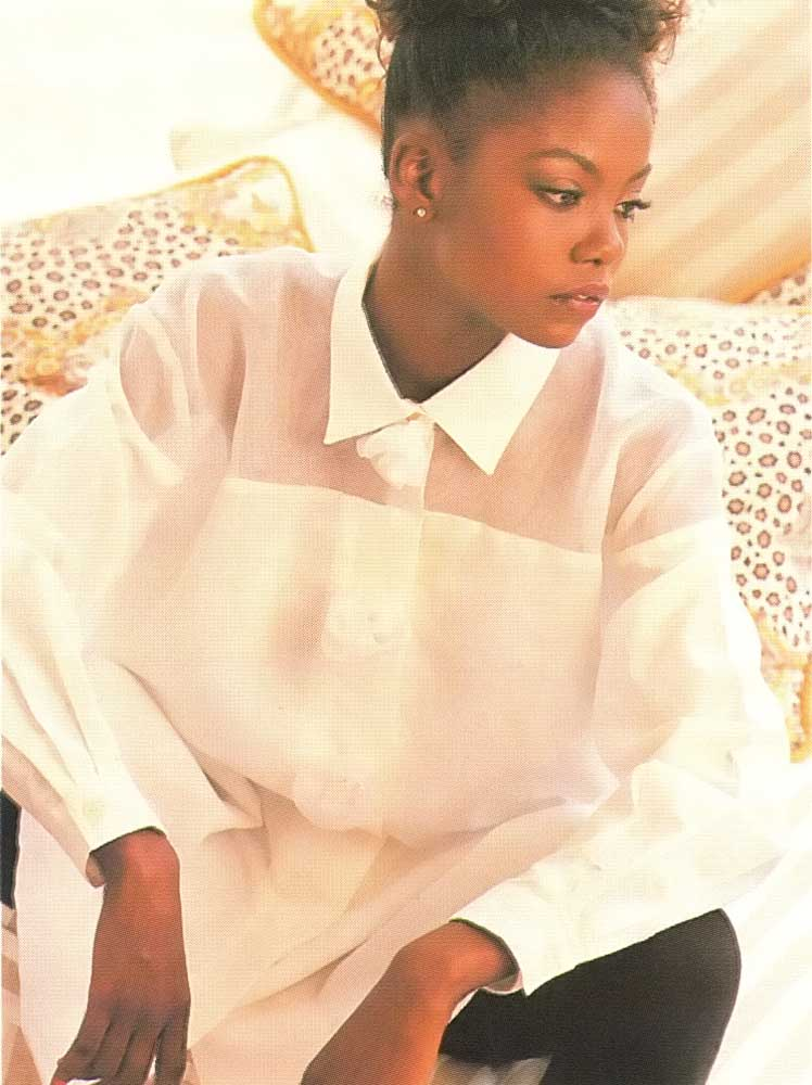 This elegant white linen smock is decorated with organza yoke and organza roses. Photograph by Steve Cohn