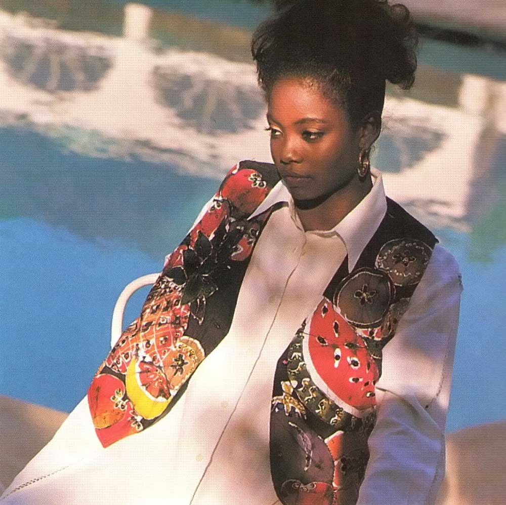 The batik and beaded vest with its fruit design perfectly offsets the white linen of the shirt, with its hand faggotting down the sleeves and front panel. Photograph by Steve Cohn