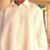 Hand faggotting adorns the front panel and sleeves of this stylish white linen shirt. Photograph by Steve Cohn