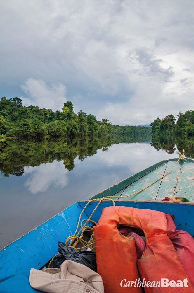 Travelling up the Potaro River. Photograph by Nikhil Ramkarran