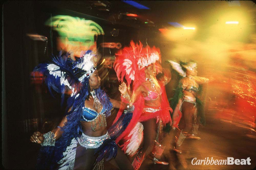 The Plantation Dinner Show features leggy dancers in feathers, a flame thrower, and moko jumbies who depict Caribbean life and carnivals