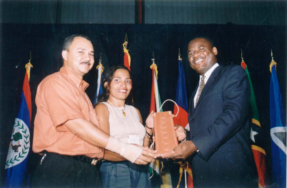 Barbados's Minister of Industry and International Business, Reginald Farley (right), presenting an award to winning participants. Photograph courtesy CGCS