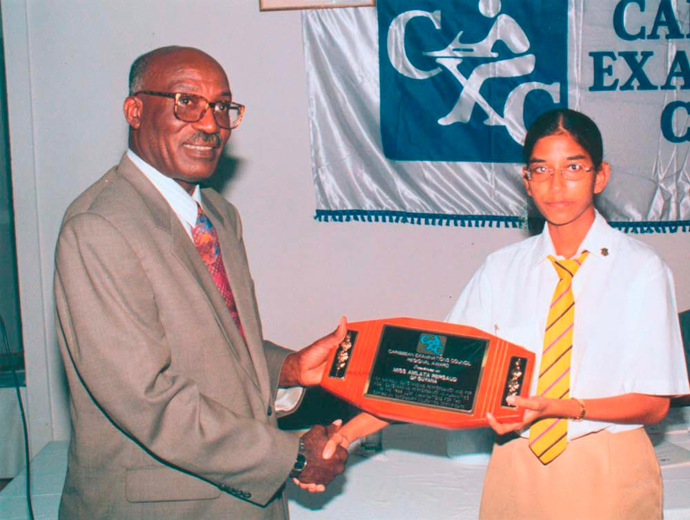 Amlata Persaud of Guyana receives her award from Sir Keith Hunte. Photograph by Caribbean Examination Council