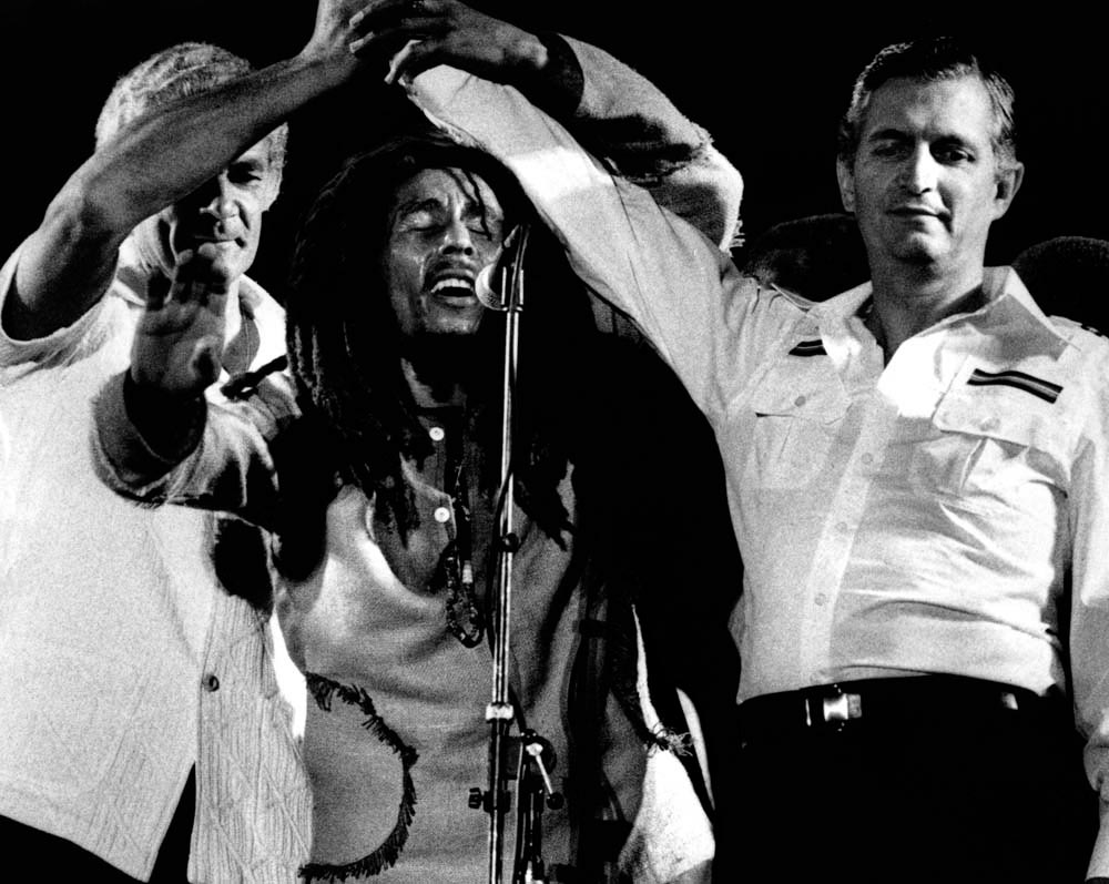 Marley with the late Michael Manley (left), prime minister of Jamaica, and Opposition Leader Edward Seaga at the One Love Peace Concert in Jamaica in 1978. Photograph by Adrian Boot