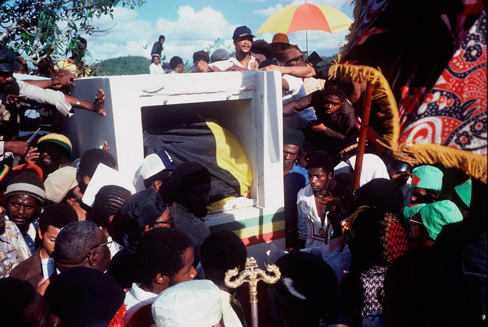 Mourners surround Marley's grave. Photograph by Adrian Boot