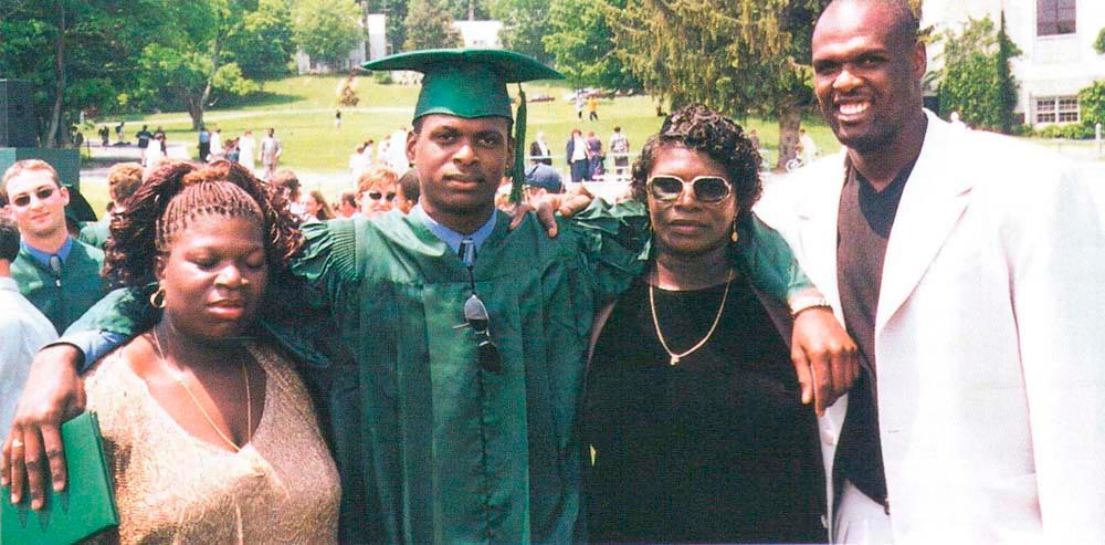 Adonal with sister Teresa (left), brother Augustine and mom Patricia at Augustine's graduation. Photograph courtesy Adonal Foyle