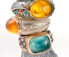 Rings (from the Alchemy collection): 18-carat gold, carved amber and silver inlaid with amber and opals;18-carat gold, amber and ivory inlaid with diamonds; aquamarine, 18-carat gold and oxidised silver inlaid with diamonds. Photograph by 
