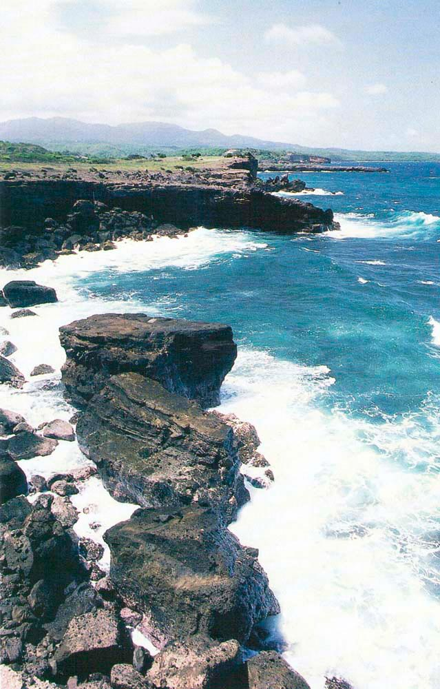 Rugged coastline at Fort Jeudy. Photograph by Chris Huxley