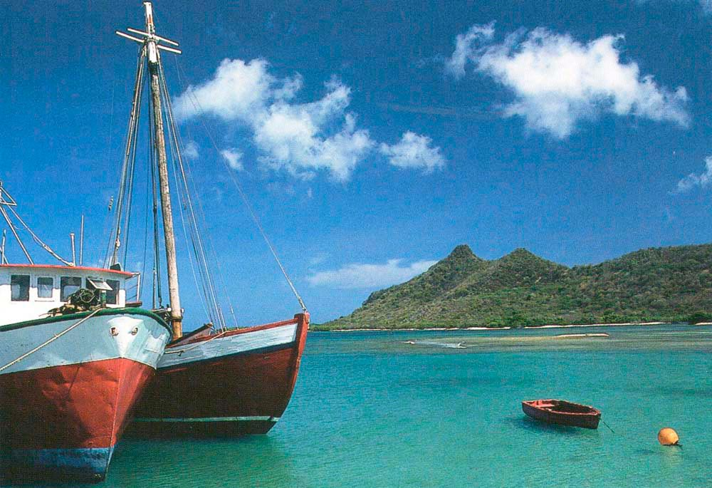Even yatchs cozy-up in Tyrell Bay, Carriacou. Photograph by Chris Huxley