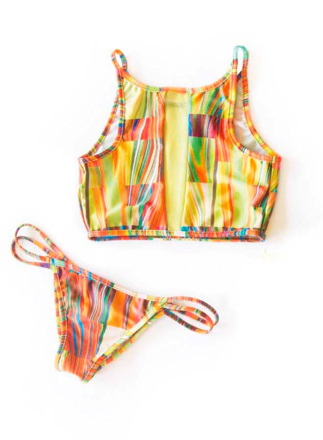 "Bright and risqué suits from the ""Print Me Crazy"" collection by Suga Apple Swim. Photography by Stephanie Kelly"