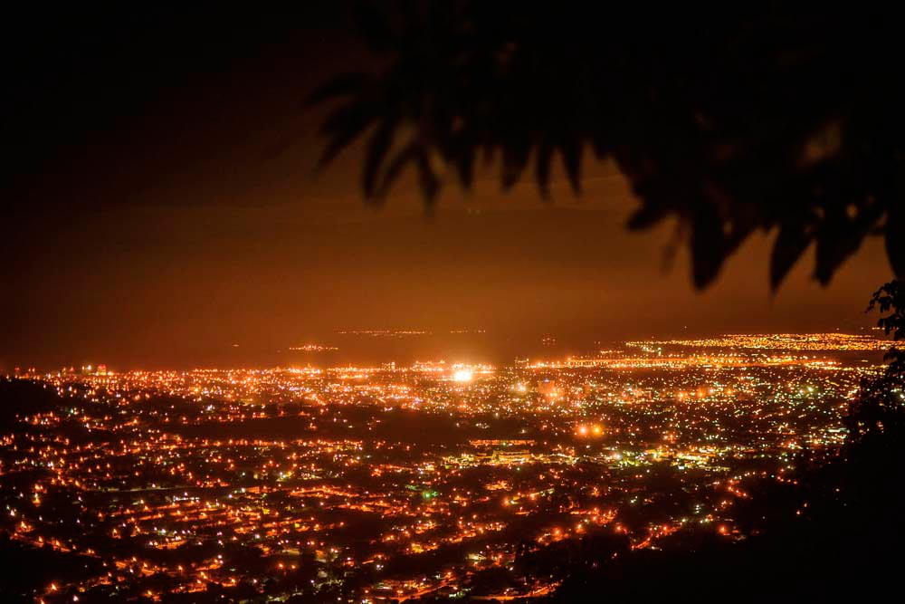 Looking down at the sprawling lights of Kingston from the Dub Club hilltop headquarters. Photograph by Matthew Henry
