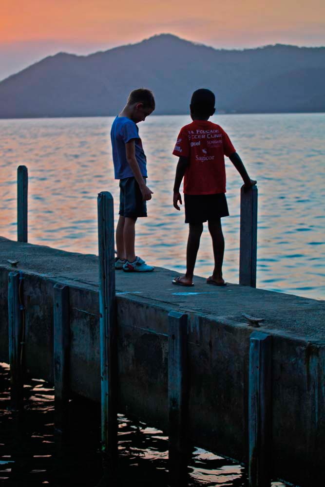 Sunset on a Gasparee jetty, with a view of Monos. Photograph by Stephen Broadbridge