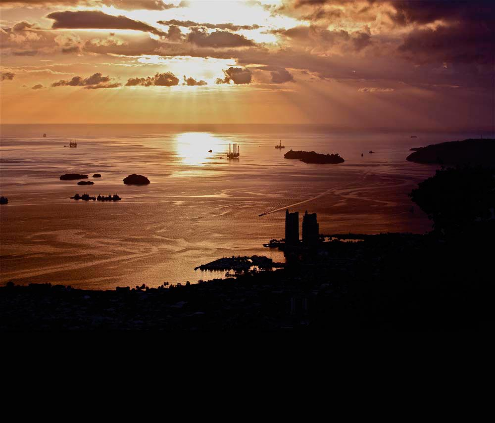 A sunset view along Trinidad's north-west peninsula, with the Five Islands in the distance. Photograph by Stephen Broadbridge