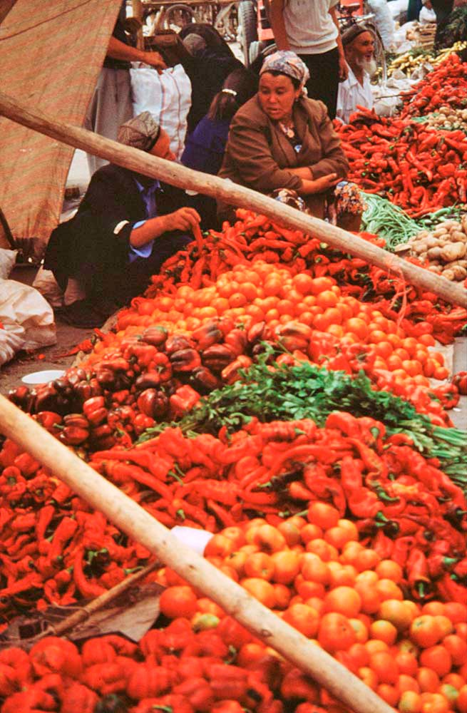Mounds of peppers on sale in the market in Kashgar, China. Photograph by Kevin Millham