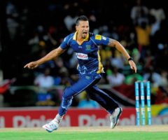 Tridents player Rayad Emrit celebrates during the 2014 final match. Photography courtesy CPL/Getty Images