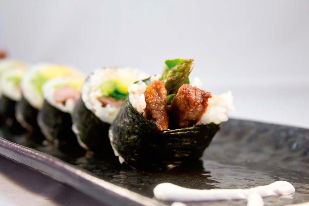 Chef Jeremy Tilokee's Joe-San (steak roll) includes beef, asparagus, and avocado. Photography courtesy Samurai