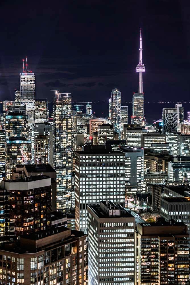 The Toronto skyline glitters by night. Photograph © ivyphotos/iStock.com