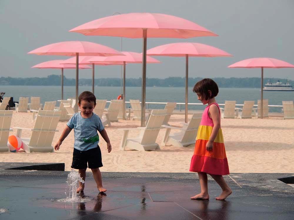 The pink umbrellas of Sugar Beach are a new Toronto landmark. Photograph courtesy www.torontowide.com
