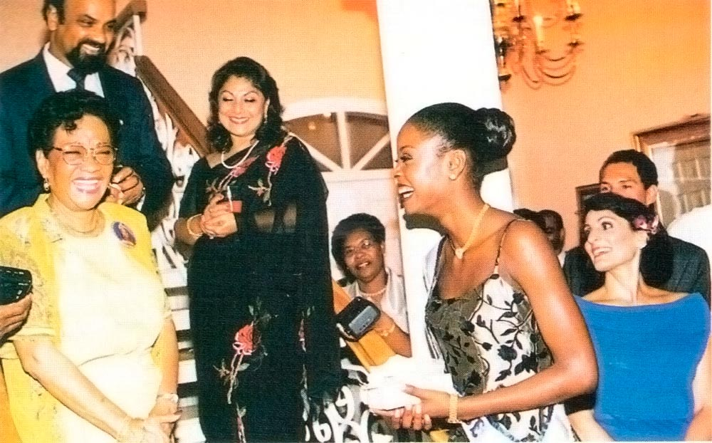 Chandradath Singh and wife with the late Kim Sabeeney (left) and Miss Universe 1998, Wendy Fitzwilliam. Photograph by Kenny Rudd