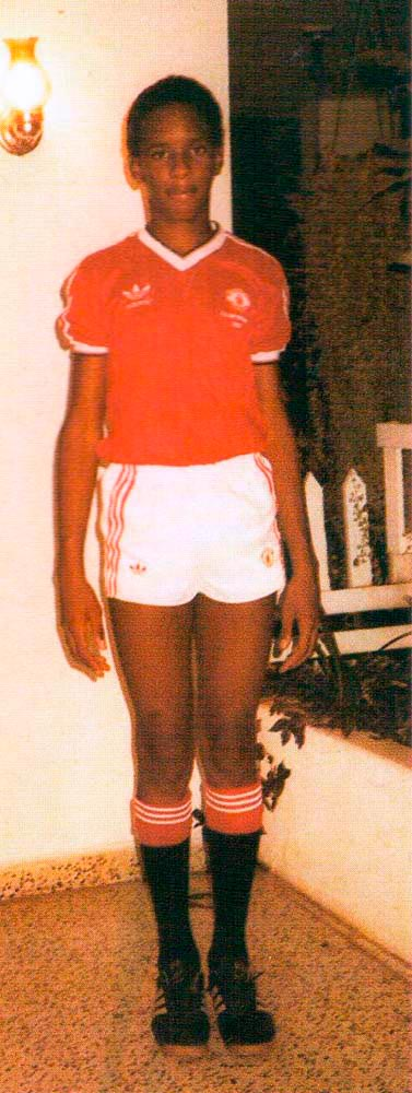 Christmas 1983: 14-year-old Shaka poses in a Manchester United uniform, a gift from his uncle. Photograph courtesy George Hislop