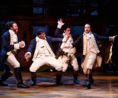 Daveed Diggs, Okieriete Onaodowan, Anthony Ramos, and composer Lin-Manuel Miranda (at right), in a scene from Hamilton