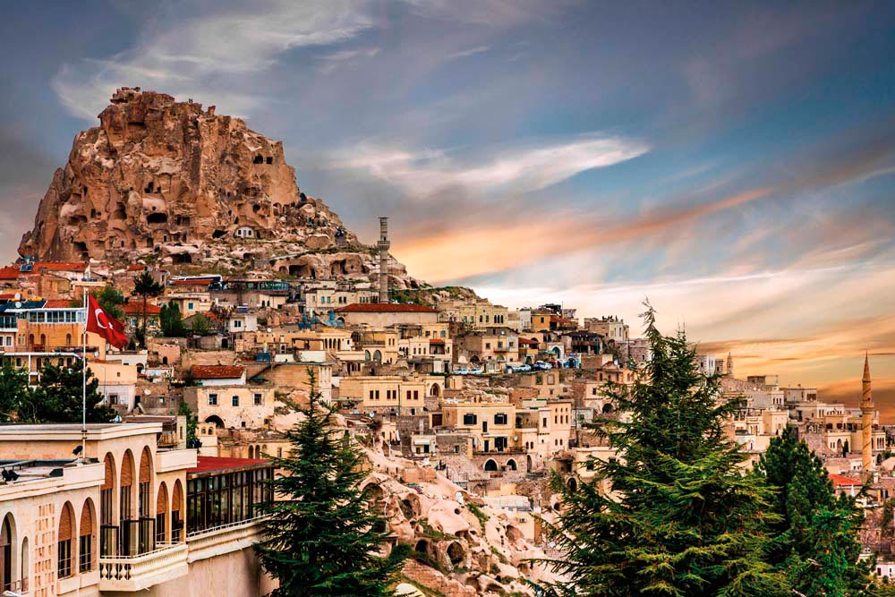 "The small town of Uhisar nestles on the slopes below its ""castle"". Photograph by Vlada Z/shutterstock.com"
