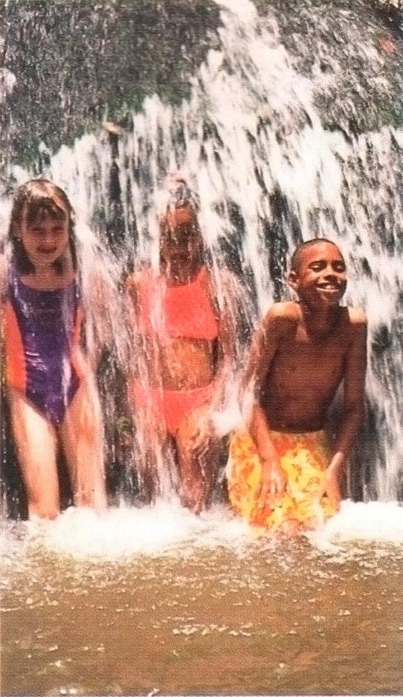 Kids at Anse La Raye waterfall. Photograph by Chris Huxley