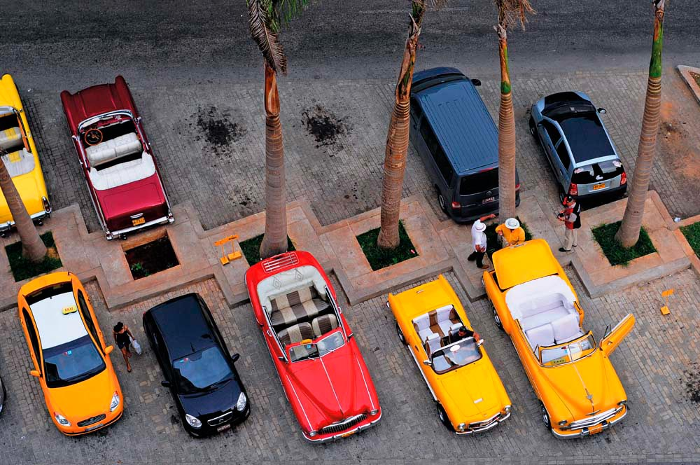 Beautifully maintained classic cars, a common sight on the streets of Havana. Photo by ToskanaINC/Shutterstock.com